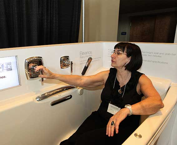 UDS attendee trying out an accessible tub