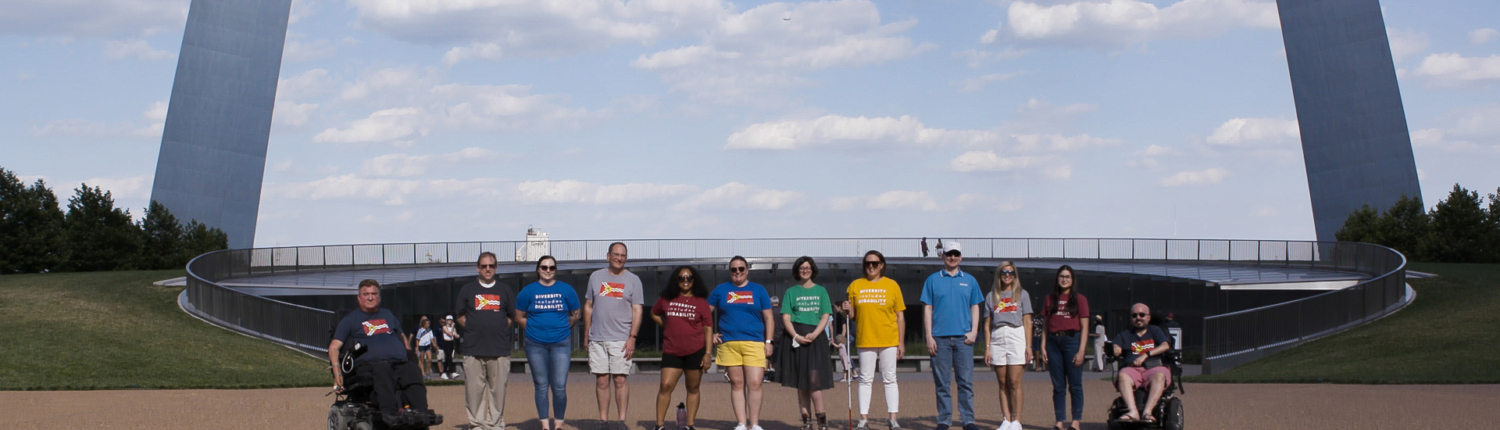 team in front of gateway arch